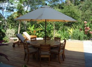 phf2016-teak-outdoor-peninsula-round-dining-table-and-chairs